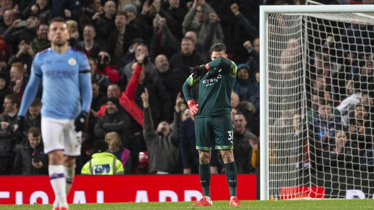 Ederson of Manchester City looks dejected after his side concede their second goal to make the score 2-0 during the Premier League match between Manchester United and Manchester City at Old Trafford on March 8, 2020 in Manchester, United Kingdom