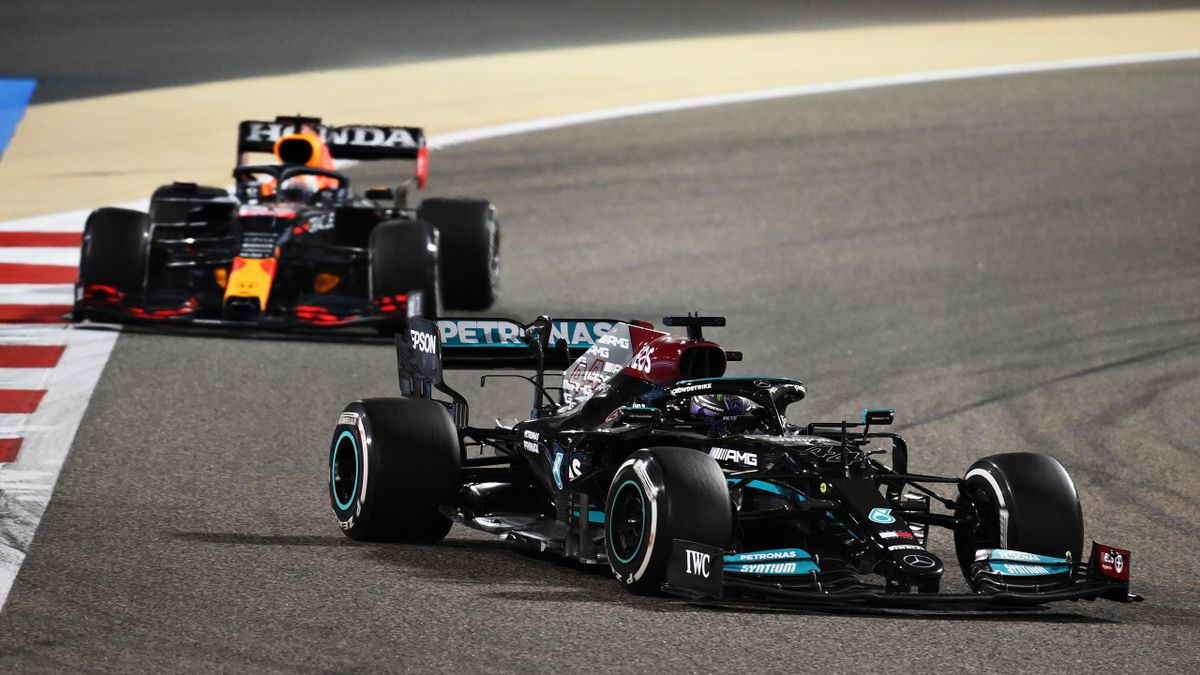 Lewis Hamilton of Great Britain driving the (44) Mercedes AMG Petronas F1 Team Mercedes W12 leads Max Verstappen of the Netherlands driving the (33) Red Bull Racing RB16B Honda on track during the F1 Grand Prix of Bahrain at Bahrain International Circuit