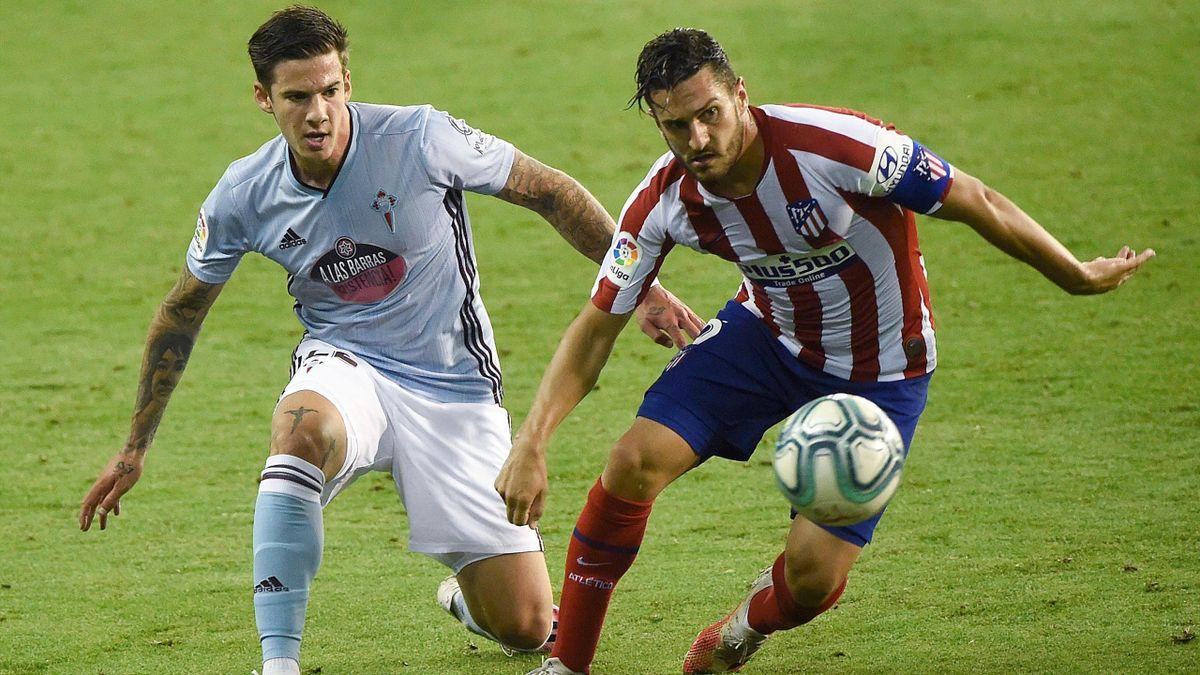 Koke (Atlético Madrid) face à Santi Mina (Celta Vigo)