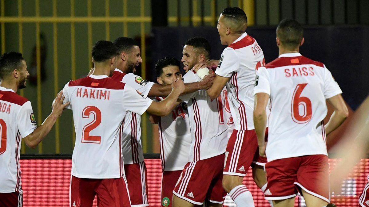 Morocco celebrate Moubarak Boussoufa's 90th-minute strike