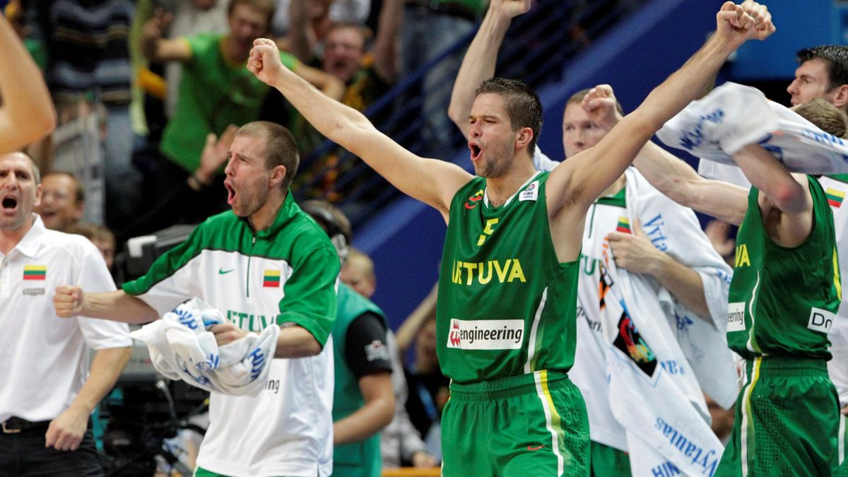 Mantas Kalnietis of Lithuania (C) and the playres on the bench celebrate in the closing moments of their team's win over Serbia during their FIBA EuroBasket 2011 Group E basketball in Vilnius