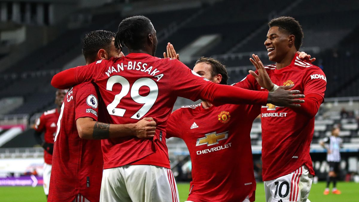 Marcus Rashford and team mates congratulate Bruno Fernandes on scoring his sides second goal during the Premier League match between Newcastle United and Manchester United at St. James Park on October 17, 2020 in Newcastle upon Tyne