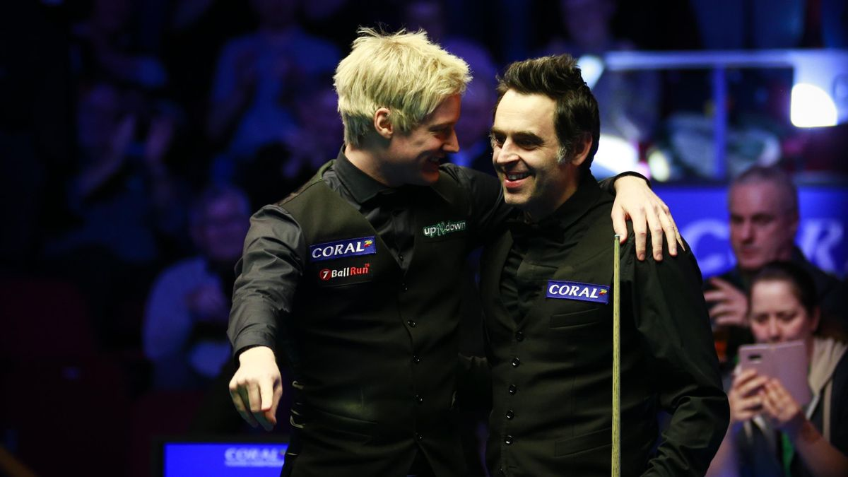 Ronnie O'Sullivan (R) of England and Neil Robertson of Australia react during the final match on day seven of the 2019 Coral Players Championship at Preston Guild Hall on March 10, 2019 in Preston, England.