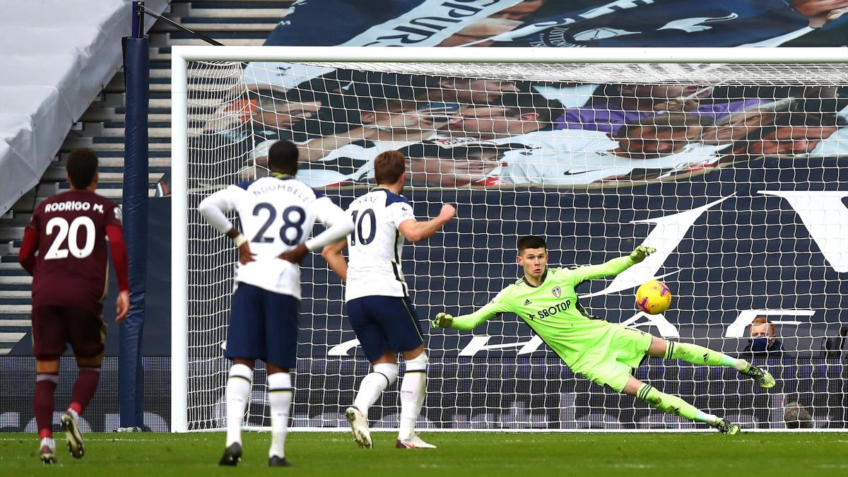 Harry Kane of Tottenham Hotspur scores their team's first goal from the penalty spot past Illan Meslier of Leeds United during the Premier League match between Tottenham Hotspur and Leeds United at Tottenham Hotspur Stadium on January 02, 2021 in London,