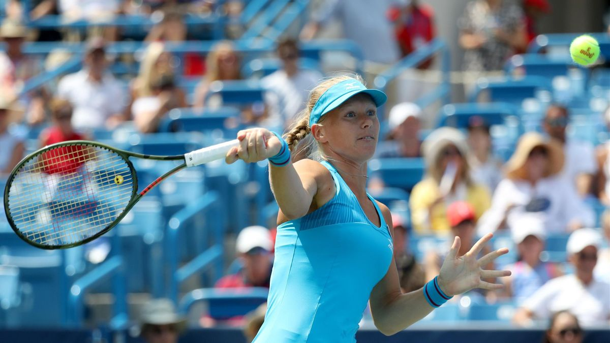 Kiki Bertens of the Netherlands returns a shot to Simona Halep of Romania during the womens final during Day 9 of the Western and Southern Open at the Lindner Family Tennis Center on August 19, 2018 in Mason, Ohio.