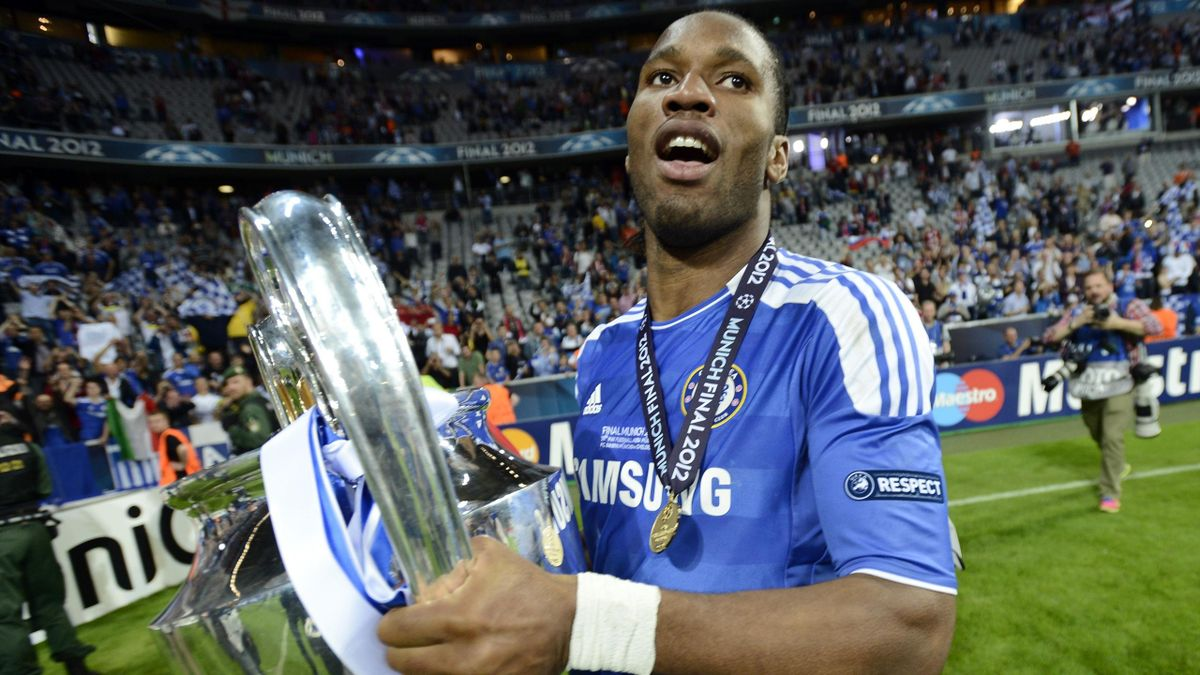 Didier Drogba of Chelsea celebrates with the UEFA Champions League trophy after his team's final soccer match against Bayern Munich at the Allianz Arena in Munich, May 19, 2012