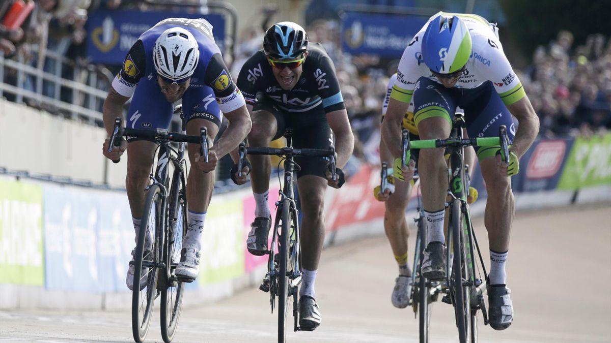 Australia's Mathew Hayman (R) sprints to win ahead of Belgium's Tom Boonen (L) and Great Britain's Ian Stannard (C)