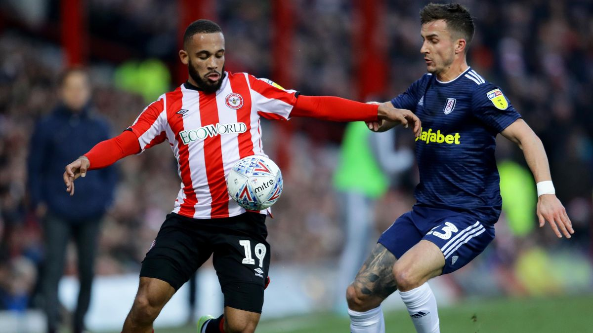 Bryan Mbeumo of Brentford is tackled by Joe Bryan of Fulham during the Sky Bet Championship match between Brentford and Fulham at Griffin Park on December 14, 2019