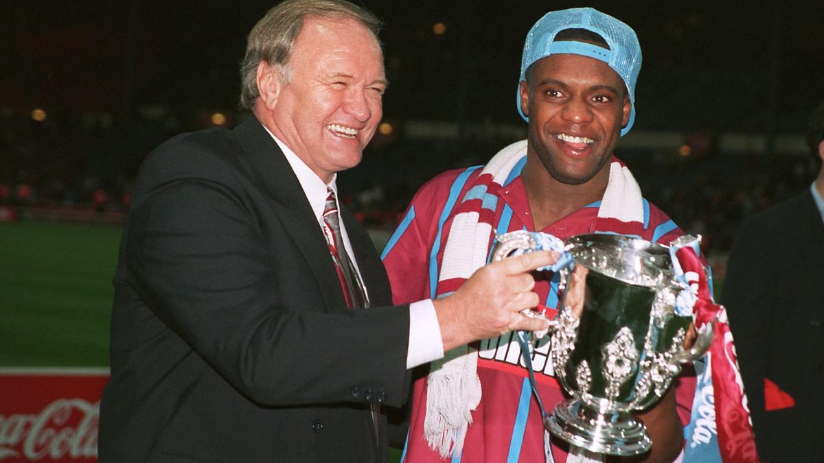 Aston Villa manager Ron Atkinson and player Dalian Atkinson celebrate with the trophy