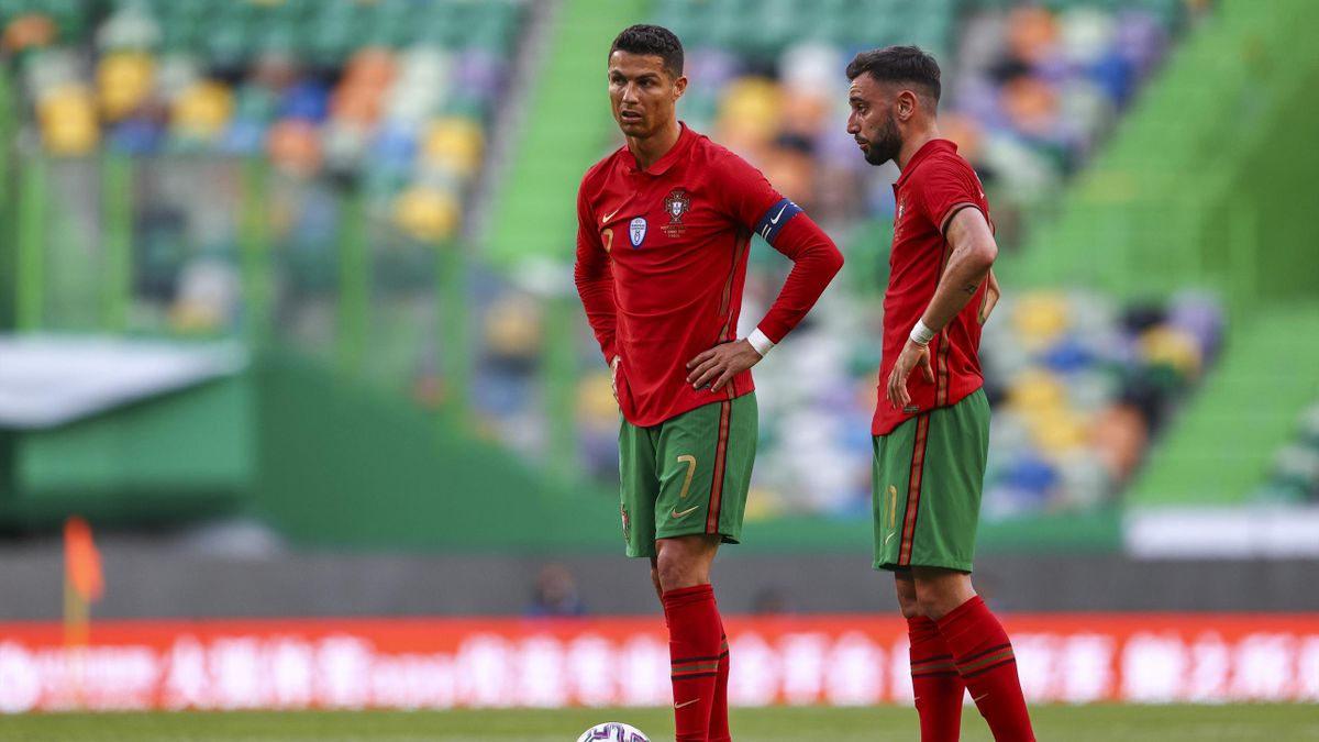 Cristiano Ronaldo of Portugal and Juventus talks Bruno Fernandes of Portugal and Manchester United in action during the international friendly match between Portugal and Israel at Estadio Jose Alvalade on June 9, 2021 in Lisbon, Portugal