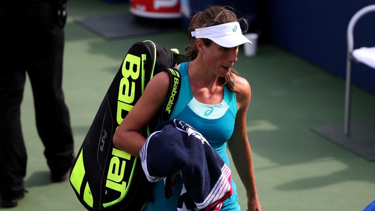 Johanna Konta leave the court after losing to Aleksandra Krunic