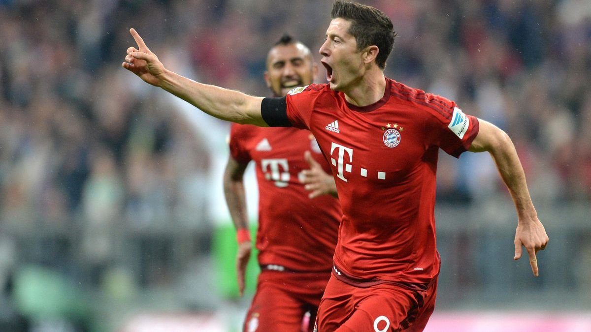 Robert Lewandowski celebrates one of his five goals for Bayern v Wolfsburg