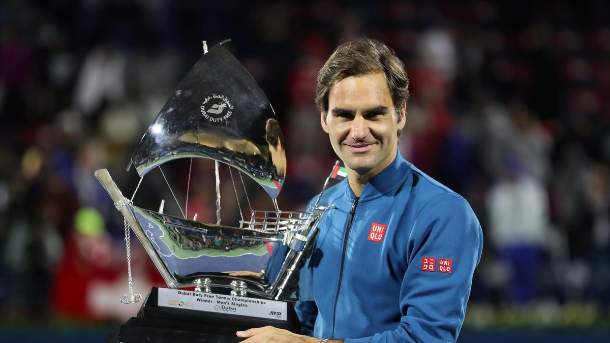 Switzerland's Roger Federer poses with the trophy after winning the Final against Greece's Stefanos Tsitsipas