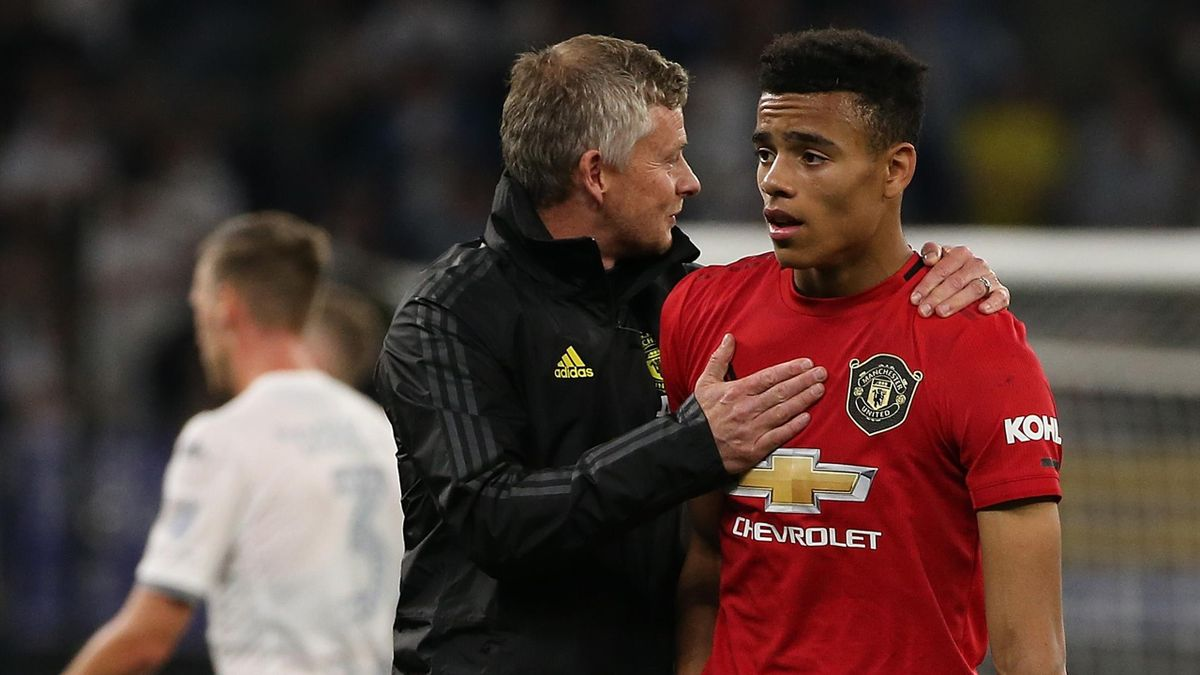 Ole Gunnar Solskjaer manager of Manchester United talks with Mason Greenwood as players walk from the field at half time during a pre-season friendly match between Manchester United and Leeds United at Optus Stadium on July 17, 2019 in Perth, Australia.