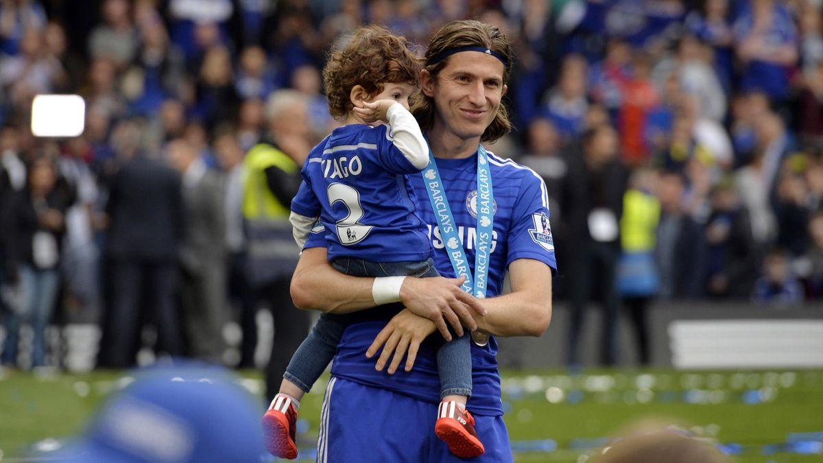 Chelsea's Filipe Luis celebrates after winning the Barclays Premier League