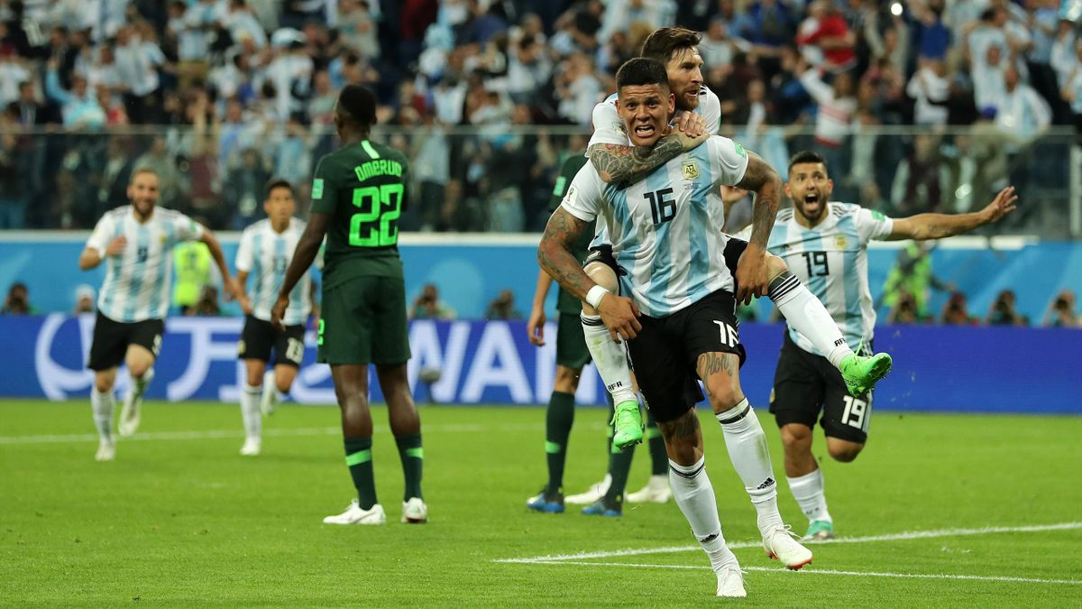 Marcos Rojo of Argentina celebrates after scoring his team's second goal with teammate Lionel Messi during the 2018 FIFA World Cup Russia group D match between Nigeria and Argentina at Saint Petersburg Stadium on June 26, 2018 in Saint Petersburg, Russia.