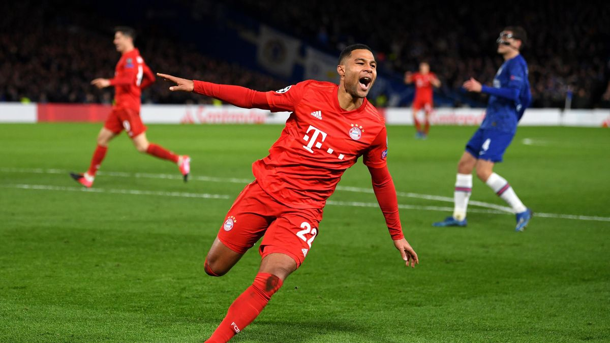 : Serge Gnabry of Bayern Munich celebrates after scoring his team's second goal during the UEFA Champions League round of 16 first leg match between Chelsea FC and FC Bayern Muenchen at Stamford Bridge on February 25, 2020 in London, United Kingdom.
