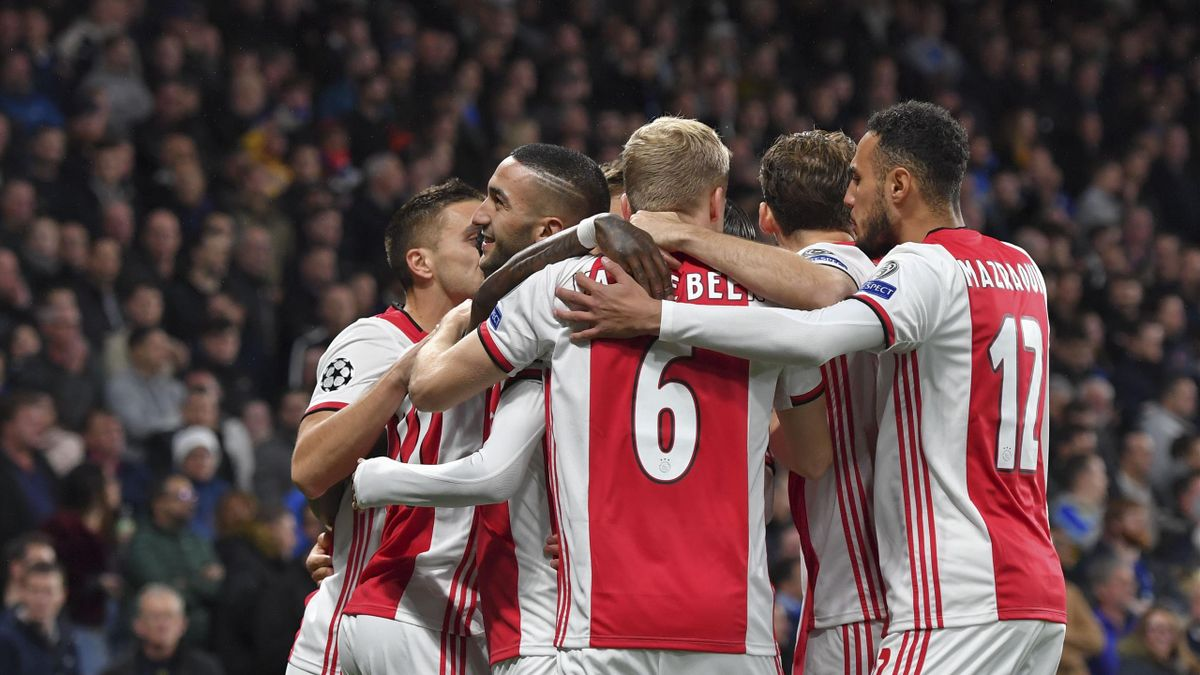 Players of Ajax Amsterdam celebrate after scoring his team's first goal during the UEFA Champions League group H match between Chelsea FC and AFC Ajax at Stamford Bridge on November 5, 2019 in London, United Kingdom