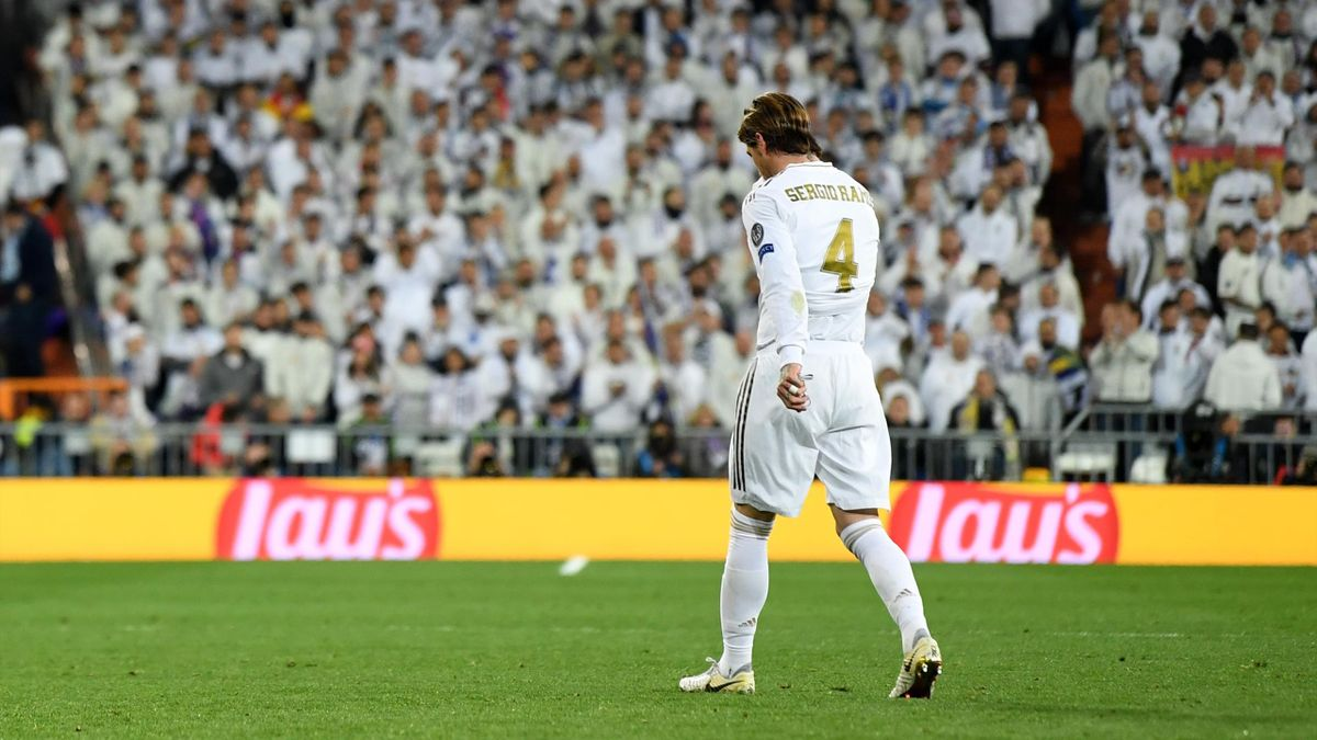 Sergio Ramos of Real Madrid looks dejected as he leaves the pitch after receiving a red card during the UEFA Champions League round of 16 first leg match between Real Madrid and Manchester City at Bernabeu on February 26, 2020 in Madrid, Spain