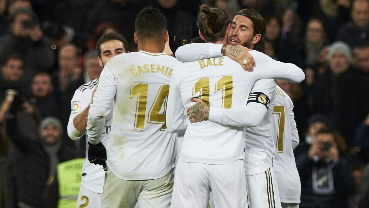 Defender Sergio Ramos of Real Madrid CF celebrates with Forward Gareth Bale after scoring during the Liga match between Real Madrid CF and Real Sociedad at Estadio Santiago Bernabeu on November 23, 2019 in Madrid, Spain