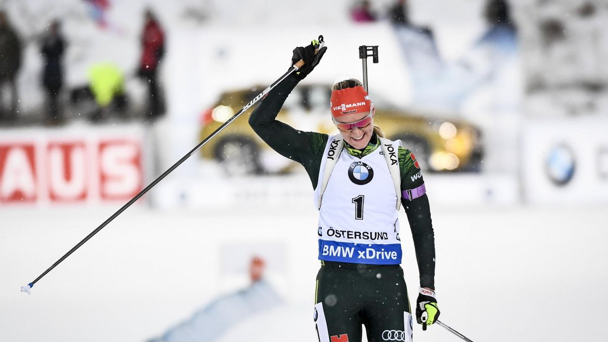 Denise Herrmann of Germany crosses the finish line to win the women's 10 km pursuit event at the IBU World Cup Biathlon on December 3, 2017 in Ostersund, Sweden.