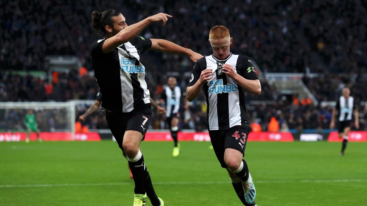 Matthew Longstaff of Newcastle United celebrates with teammate Andy Carroll after scoring his team's first goal during the Premier League match between Newcastle United and Manchester United at St. James Park on October 06, 2019 in Newcastle upon Tyne, Un