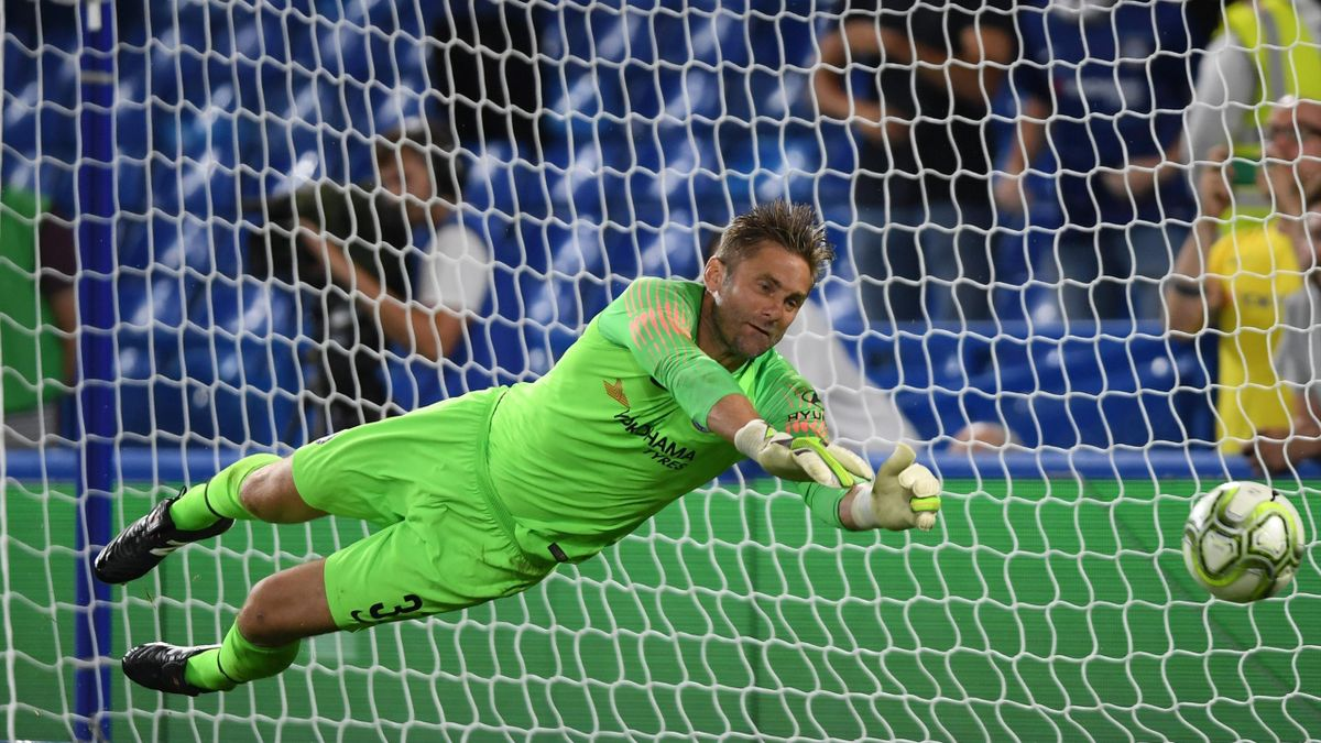 Robert Green of Chelsea saves a penalty which leads Chelsea to win a penalty shootout during the pre-season friendly match between Chelsea and Lyon at Stamford Bridge on August 7, 2018 in London, England.
