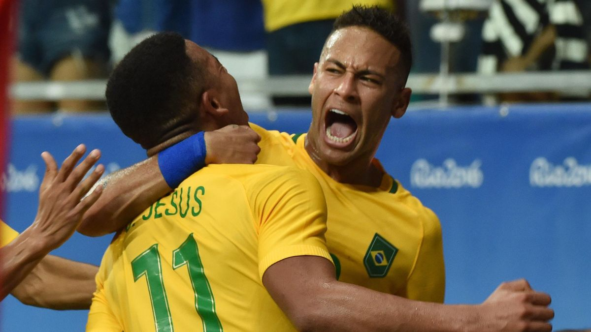 Gabriel Jesus (L) of Brazil celebrates with teammate Neymar his goal against Denmark during the Rio 2016 Olympic Games men's first round Group A football match Brazil vs Denmark, at the Arena Fonte Nova Stadium in Salvador, Brazil on August 10, 2016