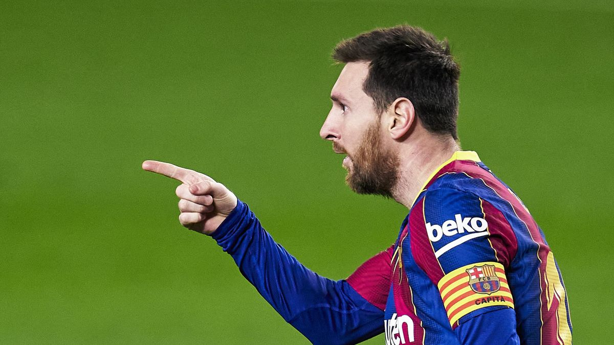 Lionel Messi of FC Barcelona celebrates after scoring his team's opening goal during the La Liga Santander match between FC Barcelona and Elche CF at Camp Nou on February 24, 2021