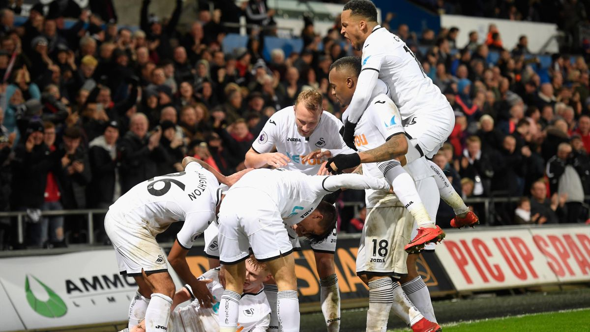 Samuel Clucas of Swansea City celebrates with team mates after scoring his sides third goal during the Premier League match between Swansea City and Arsenal at Liberty Stadium on January 30, 2018 in Swansea, Wales