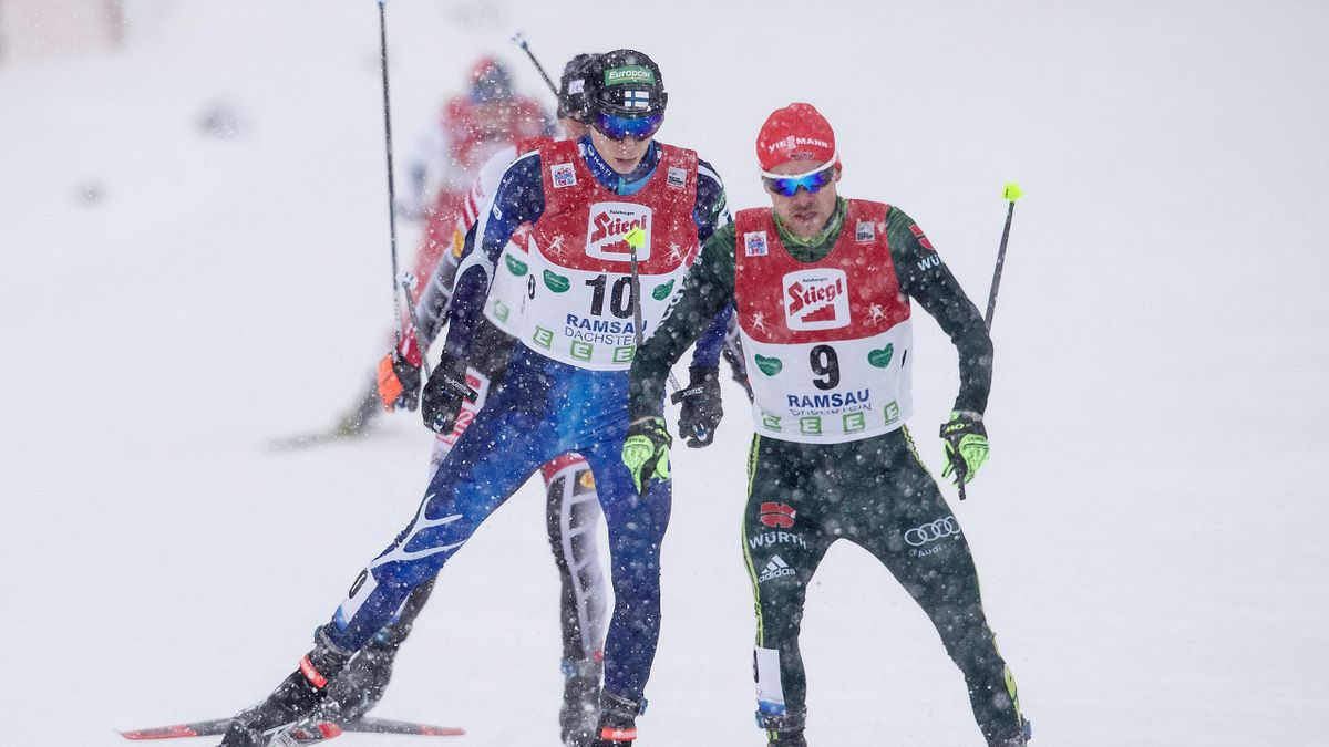 Finland's Eero Hirvonen (L) and German Fabian Riessle compete in the FIS Nordic Combined World Cup in Ramsau am Dachstein, Austria, on December 17, 2017.