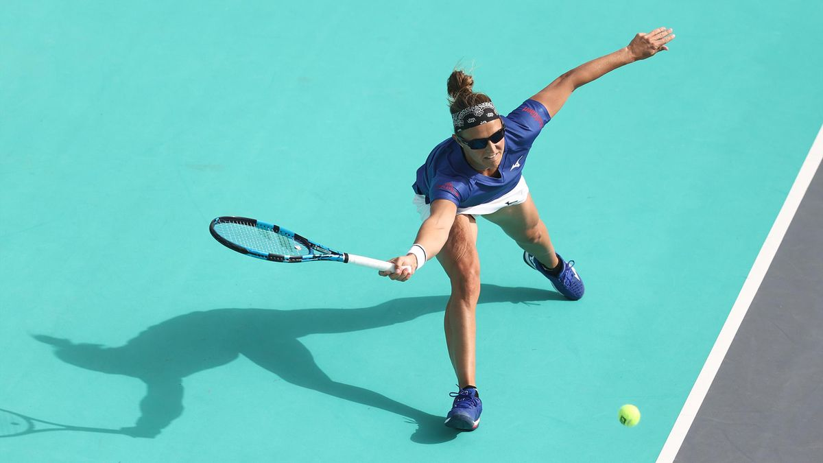Kirsten Flipkens of Belgium plays a forehand against Sofia Kenin of United States during her Women's Singles match on Day Three of the Abu Dhabi WTA Women's Tennis Open at Zayed Sports City on January 08, 2021 in Abu Dhabi, United Arab Emirates