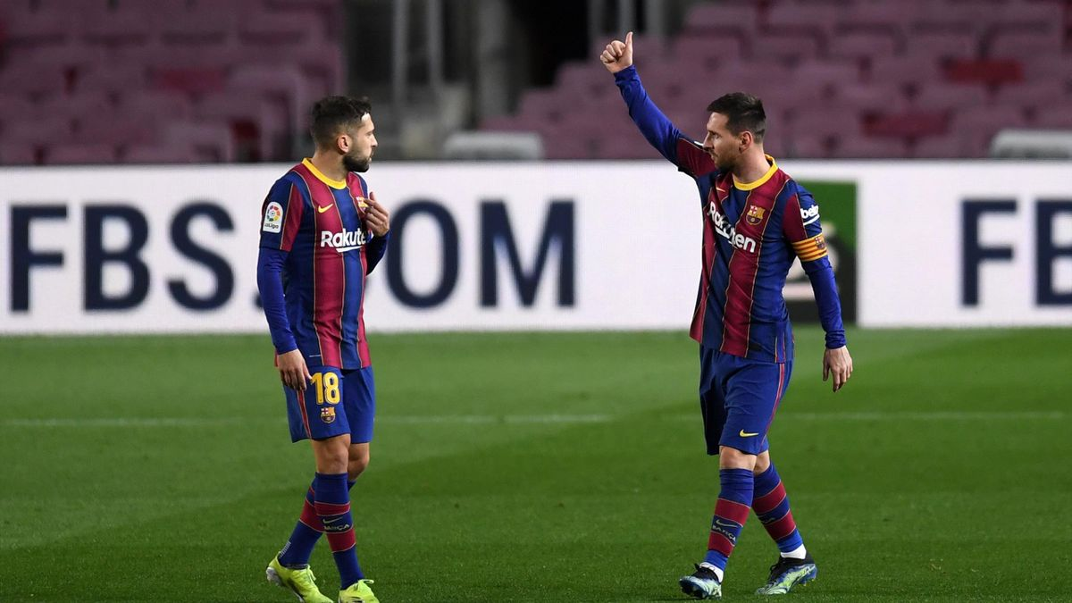 Lionel Messi of Barcelona celebrates after scoring their side's first goal as team mate Jordi Alba looks on during the La Liga Santander match between FC Barcelona and Athletic Club at Camp Nou