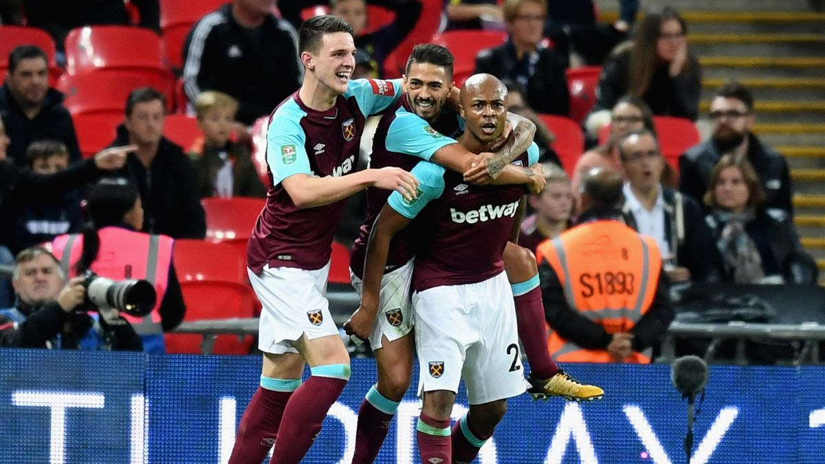 Andre Ayew of West Ham United celebrates scoring his side's second goal with team mates during the Carabao Cup Fourth Round match between Tottenham Hotspur and West Ham United at Wembley Stadium on October 25, 2017 in London, England