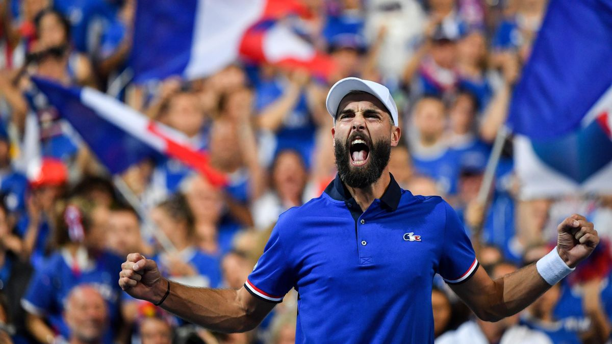 French player Benoit Paire celebrates after winning his tennis match against Spanish player Pablo Carreno Busta during the Davis Cup semi-final between France and Spain in Villeneuve-d'Ascq, northern France, on September 14, 2018.