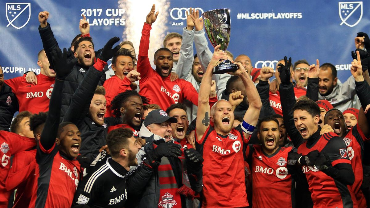 Michael Bradley #4 of Toronto FC lifts the MLS Eastern Conference Finals trophy following victory in the 2nd leg against Columbus Crew SC at BMO Field on November 29, 2017