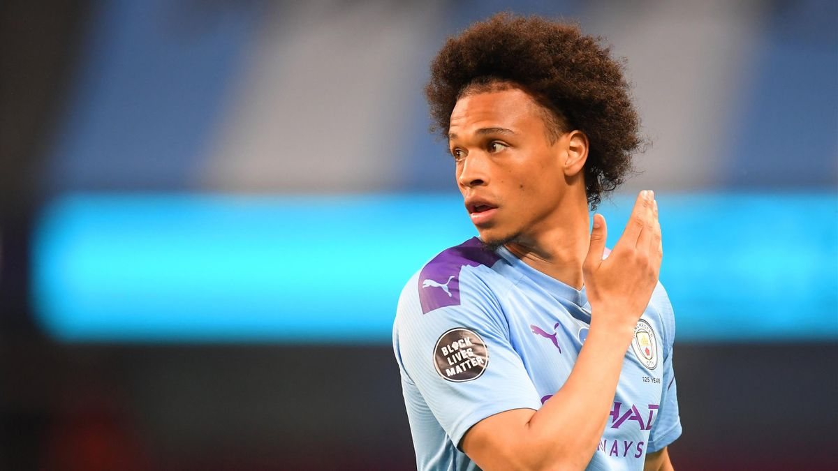 Leroy Sane of Manchester City looks on while showing the Black Lives Matter movement logo on his shirt sleeve during the Premier League match between Manchester City and Burnley FC at Etihad Stadium on June 22, 2020 in Manchester, England