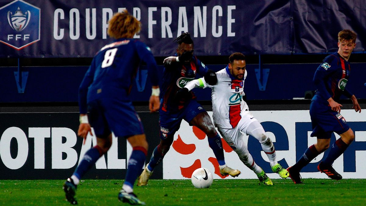 Paris Saint-Germain's Brazilian forward Neymar (2nd-R) drives the ball during the French Cup round-of-64 football match between Stade Malherbe Caen and Paris Saint-Germain at the Michel-d'Ornano Stadium in Caen, northwestern France on February 10, 2021