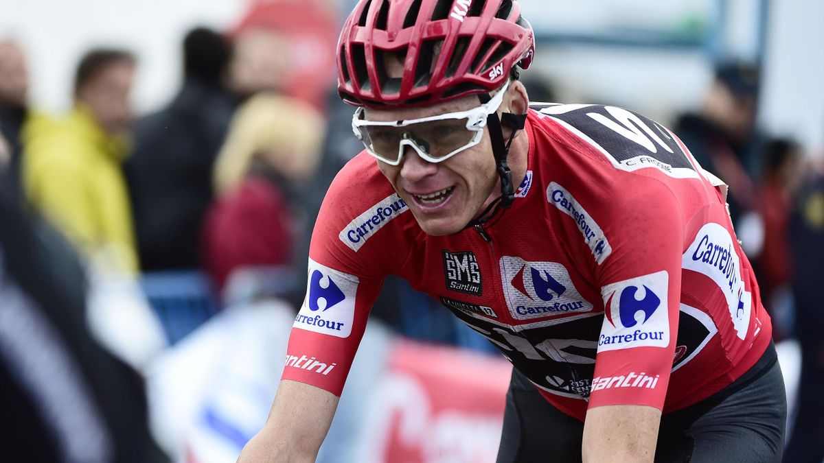 Sky's British cyclist Christopher Froome crosses the finish line of the 20th stage of the 72nd edition of 'La Vuelta' Tour