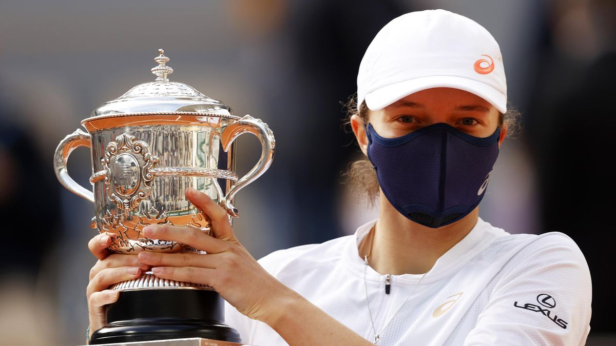 Iga Swiatek of Poland lifts the Suzanne-Lenglen cup following victory in her Women's Singles Final against Sofia Kenin of The United States of America on day fourteen of the 2020 French Open at Roland Garros