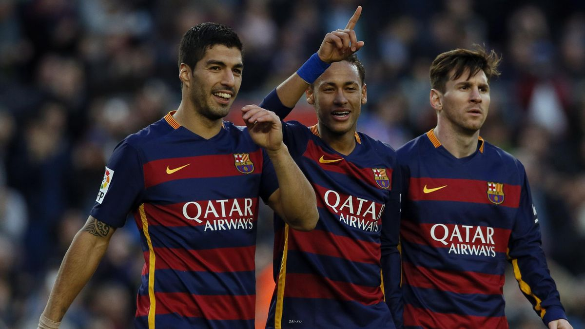 Barcelona's Neymar celebrates scoring the third goal with team mates Luis Suarez and Lionel Messi