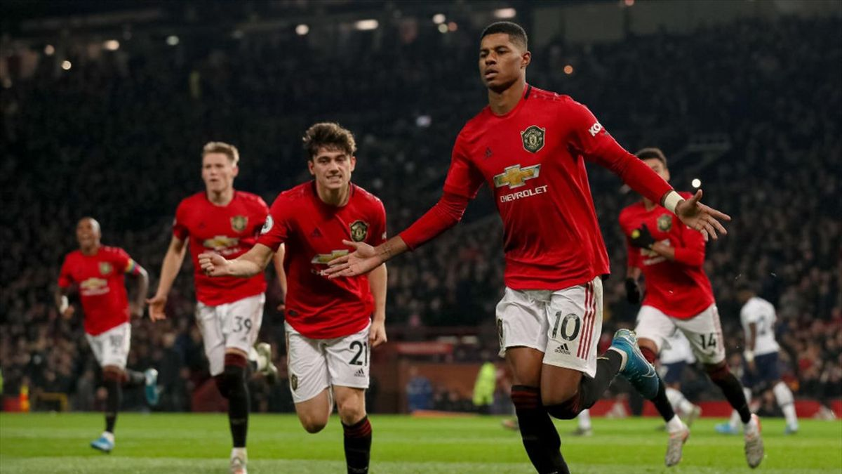: Marcus Rashford of Manchester United celebrates after scoring a goal to make it 2-1 during the Premier League match between Manchester United and Tottenham Hotspur at Old Trafford on December 4, 2019 in Manchester, United Kingdom.