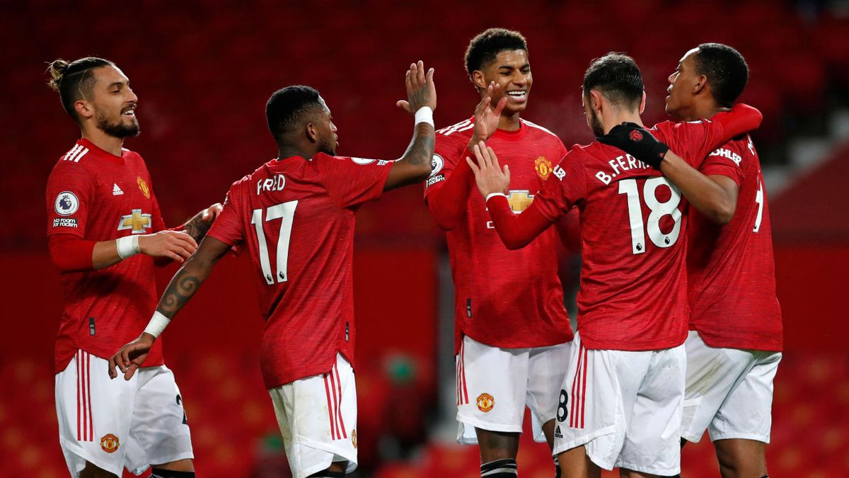 Bruno Fernandes of Manchester United celebrates with team mates (l - r) Alex Telles, Fred, Marcus Rashford and Anthony Martial after scoring their sides sixth goal during the Premier League match between Manchester United and Leeds United at Old Trafford
