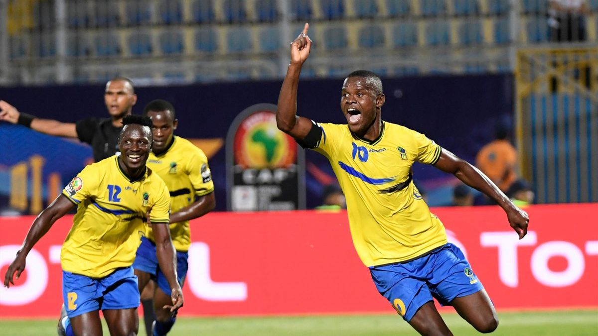 Tanzania's forward Mbwana Samatta (R) celebrates scoring his team's second goal during the 2019 Africa Cup of Nations (CAN) football match between Kenya and Tanzania at the Stadium in Cairo on June 27, 2019.