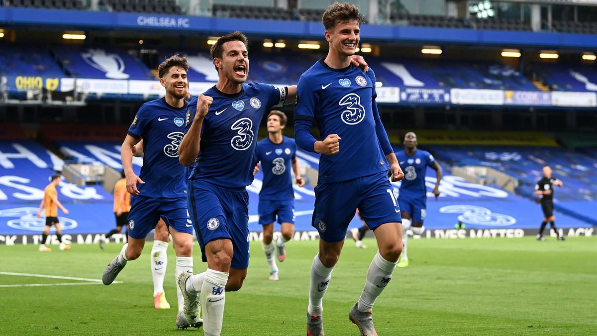 Mason Mount of Chelsea celebrates with teammate Cesar Azpilicueta after scoring his team's first goal during the Premier League match between Chelsea FC and Wolverhampton Wanderers at Stamford Bridge on July 26, 2020 in London, England. Football Stadiums