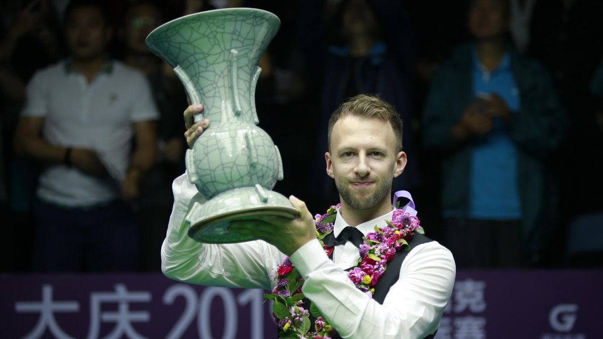 Judd Trump of England celebrates with his trophy after the final match against Shaun Murphy of England on day eight of the 2019 World Snooker International Championship at Baihu Media Broadcasting Centre on August 11, 2019 in Daqing, Heilongjiang Province