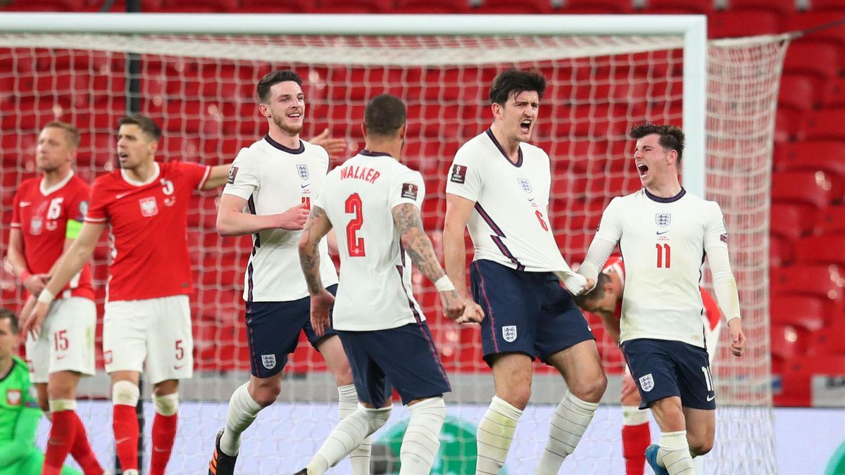 England's defender Harry Maguire (2R) celebrates scoring their second goal during the FIFA World Cup Qatar 2022 Group I qualification football match between England and Poland at Wembley Stadium in London on March 31, 2021