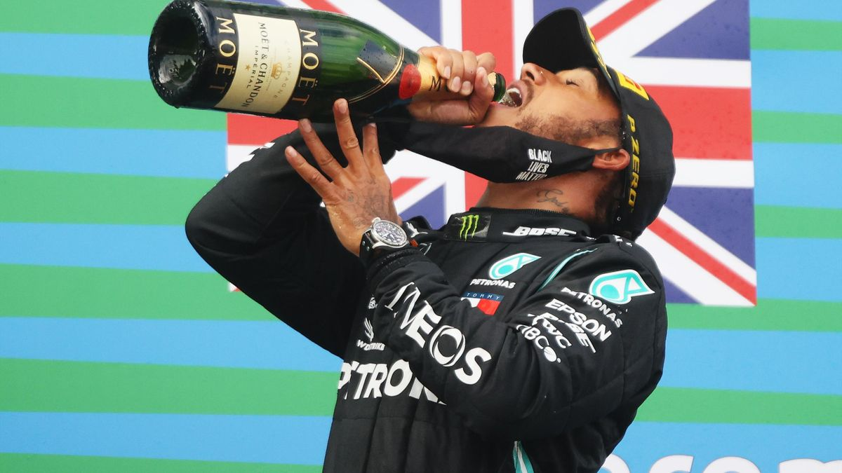 Race winner Lewis Hamilton of Great Britain and Mercedes GP celebrates on the podium during the F1 Eifel Grand Prix
