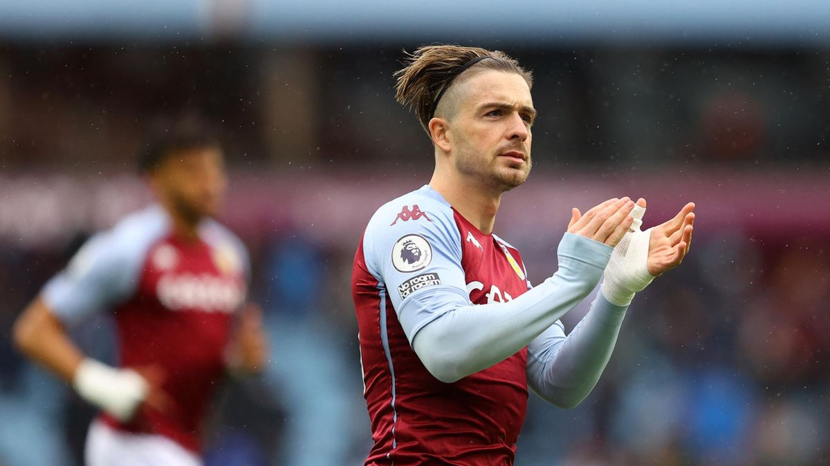 Aston Villa's English midfielder Jack Grealish applauds the fans ahead of the English Premier League football match between Aston Villa and Chelsea at Villa Park in Birmingham, central England on May 23, 2021