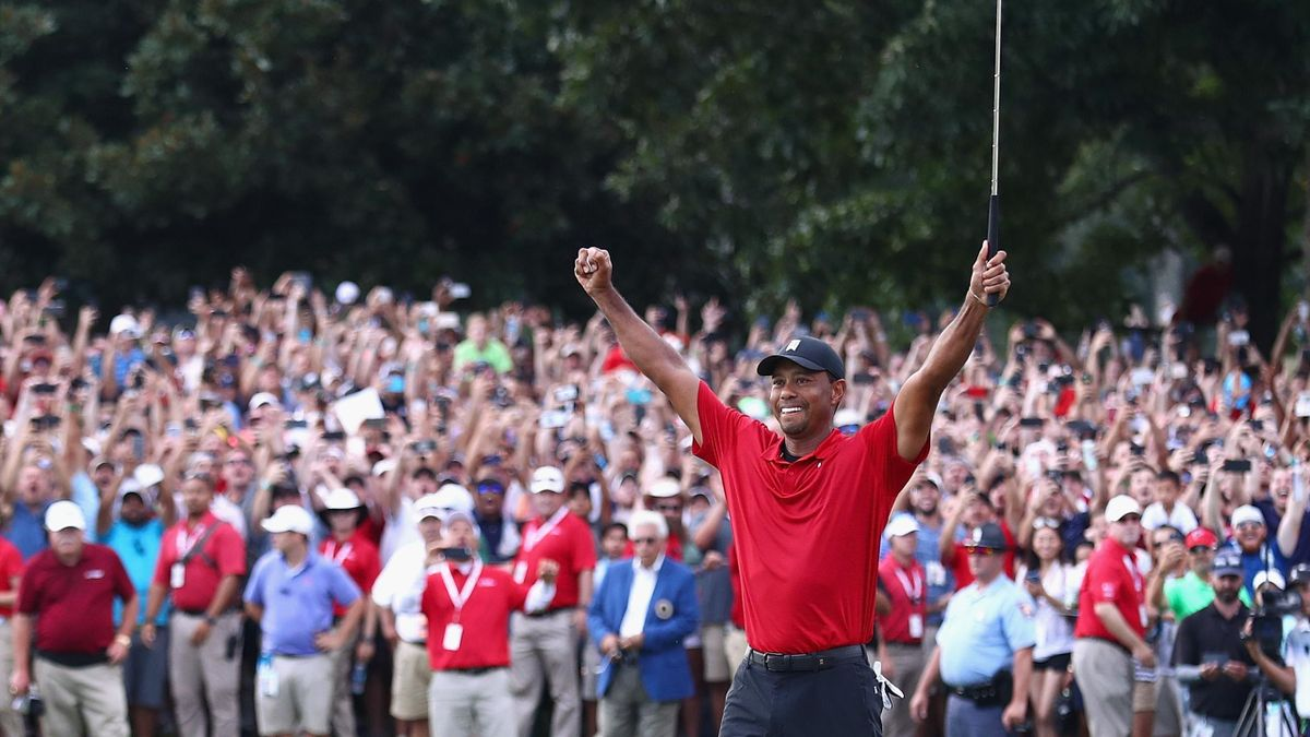 ATLANTA, GA - SEPTEMBER 23: Tiger Woods of the United States celebrates making a par on the 18th green to win the TOUR Championship at East Lake Golf Club on September 23, 2018 in Atlanta, Georgia. (Photo by Tim Bradbury/Getty Images)